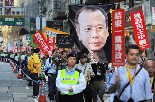 Protesters wave banners and placards as they march through Hong Kong calling for the release of jailed Chinese Nobel Peace Prize winner Liu Xiaobo. Photo: Getty Images