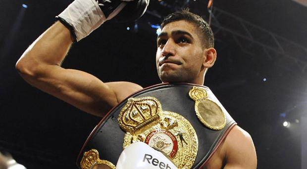 WBA champion Amir Khan has vowed to unify the light-welterweight division. Photo: Reuters