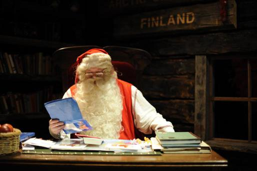 Santa Claus reads letters coming in from the world in his