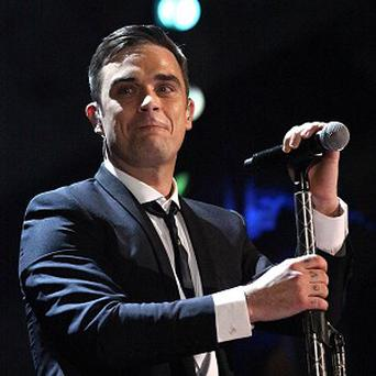 Robbie Williams will perform with boyband One Direction