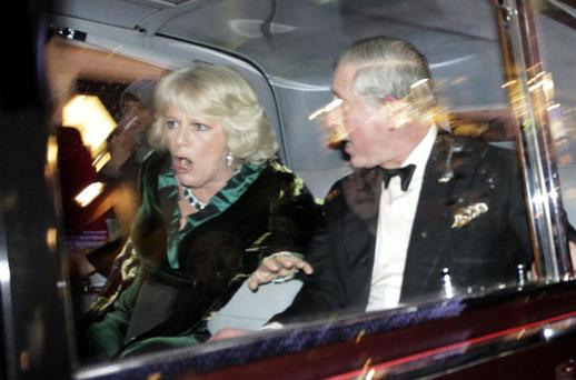 Britain's Prince Charles and Duchess Camilla react as their car is attacked by a breakaway group of student protesters in London on Thursday. AP PHOTO/MATT DUNHAM