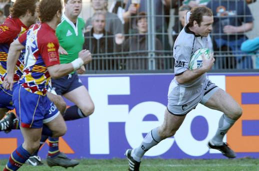 Leicester's Geordan Murphy runs in his side's only try in the defeat to Perpignan yesterday. Photo: AP