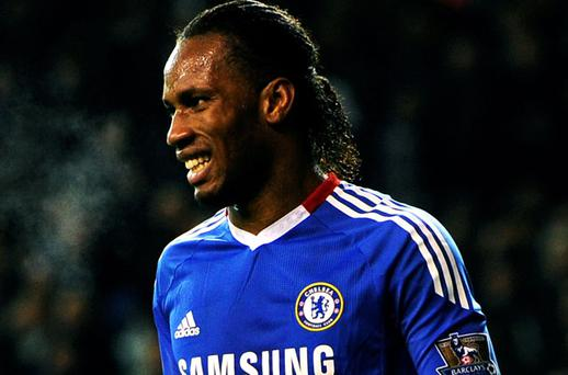 Didier Drogba shows his disappointment after his last-minute penalty was saved by Heuerelho Gomes. Photo: Getty Images