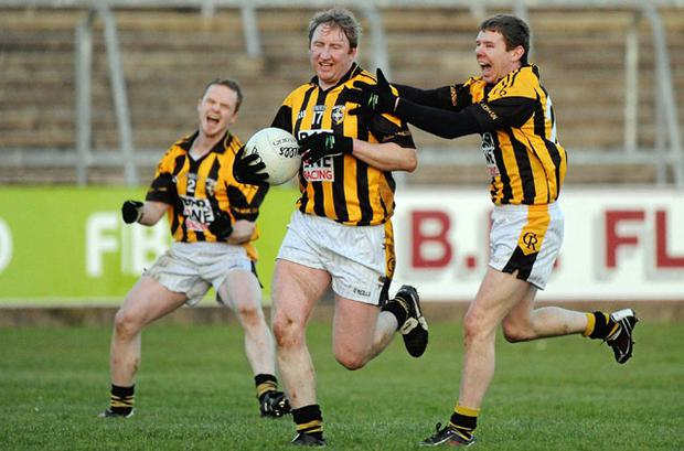 Crossmaglen's Paul McKeown, Francie Bellew and Martin Ahearne celebrate celebrate their victory as the referee blows the final whistle. Photo: Oliver McVeigh / Sportsfile