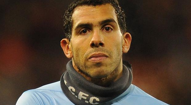 Tevez: determined to leave City. Photo: Getty Images