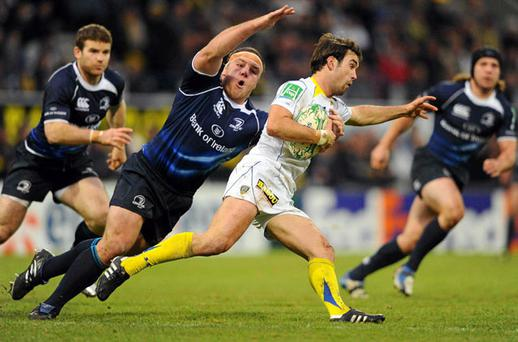 Clermont's Morgan Parra is tackled by Heinke van der Merwe. Photo: Stephen McCarthy / Sportsfile