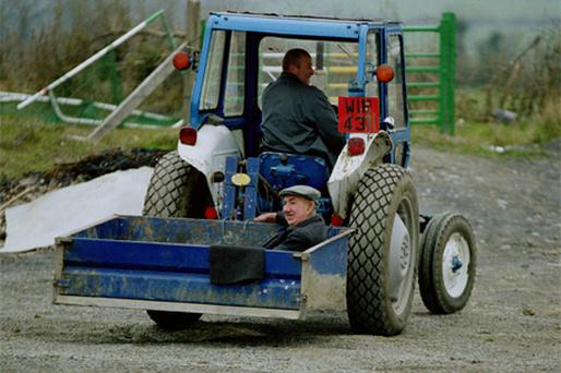Patrick Delaney is driven by Patrick Brennan to a GAA match in Laois in April 2000
