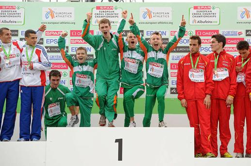 The Ireland U23 team, from left, John Coghlan, David Rooney, Michael Mulhare, David McCarthy and Brendan O'Neill step on to the podium to receive their team gold. Photo: Brendan Moran / Sportsfile