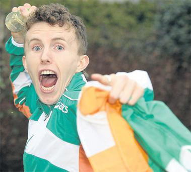 Ireland Men's U-23 gold medal winning team member Brendan O'Neill celebrates with his gold medal at Dublin Airport yesterday. Photo: Sportsfile