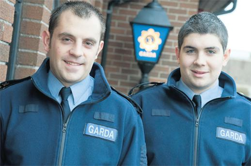 Gardai John O'Sullivan and Reserve Garda Peter Clifford who rescued May O'Gorman from the house in Cork city