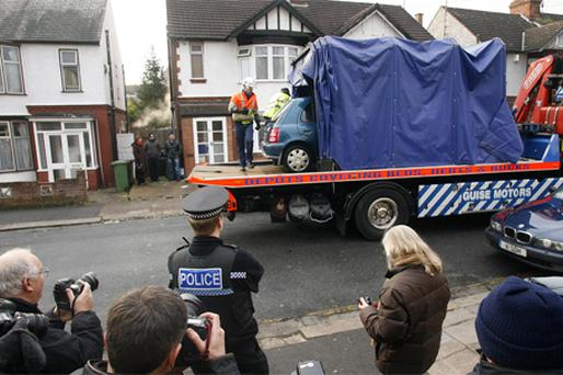 A car is removed from outside a house which was searched by British police in Luton yesterday in connection with the death of suicide bomber Taimour Abdulwahab al-Abdaly in Sweden over the weekend