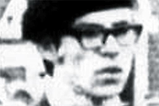 A young Gerry Adams is pictured wearing a black beret at a funeral in Belfast in 1971