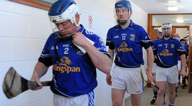 Daithi Neary leads the Cavan senior hurling team out at Healy Park, Omagh, last May ahead of their Ulster SHC Championship first round clash with Tyrone - whether they return to competitive action next year remains unclear.