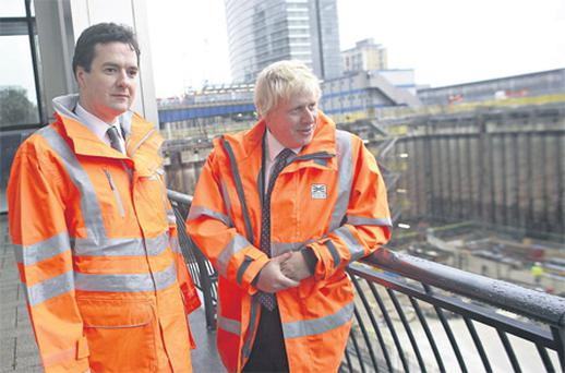 UK Chancellor of the Exchequer George Osborne, left, and Boris Johnson, London's mayor, look at the Crossrail rail-link project at Canary Wharf in London