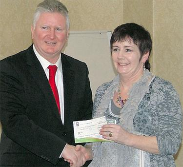 Dorothy Minoghue Landers, Tulla, accepts her Clare Farm Idea Awards prize from Senan Keane of sponsors Clean Ireland Recycling