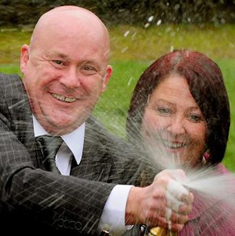 Neil Jones, 47 and Julie Kirkham, 43, celebrate winning almost £2.5 million on the Lottery