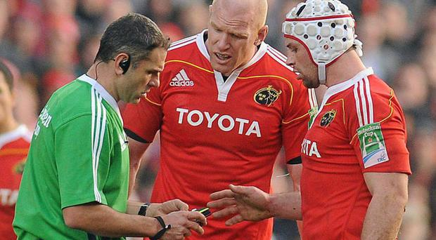 Sunday's ref Christophe Berdos reaches for the red card despite the protestations of Paul O'Connell and Denis Leamy (R).