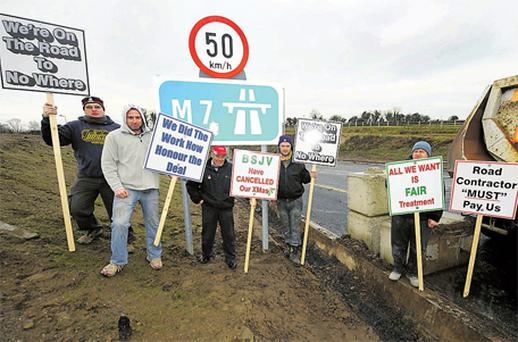 Men working on the M7 near Roscrea, Co Tipperary, block an entry to the motorway in protest over unpaid wages