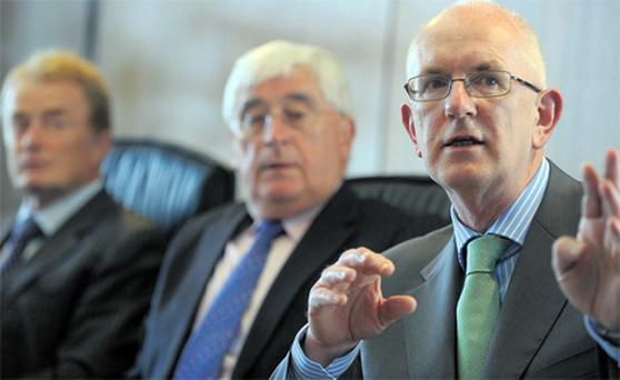 Barry O'Leary, CEO of the IDA, making a point at a press conference where he announced the IDA is on target to achieve foreign direct investments, flanked by Batt O'Keeffe, Minister for Enterprise, Trade and Innovation, and Liam O'Mahony, IDA chairman