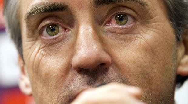 Manchester City manager Roberto Mancini answers questions in Turin yesterday. Photo: AP