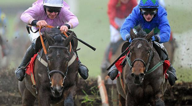 Hurricane Fly and jockey Paul Townend (right) races towards the finishing post, on the way to winning The Bar One Racing Hatton's Grace Hurdle from second-placed Solwhit, under Davy Russell, at Fairyhouse yesterday. Photo: Matt Browne / Sportsfile