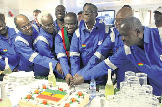 Cutting the cake of success: Tullow Oil Ghanain staff celebrate the pumping of oil from the Jubilee field off the coast in West Africa