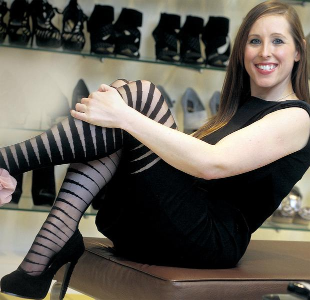 Head over heels: Leann Cuddihy even wears her heels at work. Picture by Ronan Lang