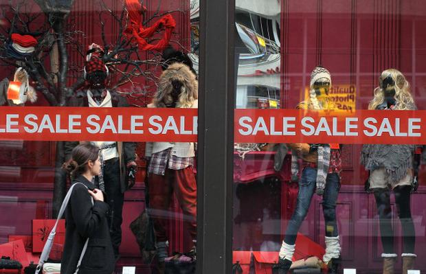 SAN FRANCISCO, CA - DECEMBER 14: A pedestrian walks by a window display of sales items at an H&M store on December 14, 2010 in San Francisco, California. As consumer confidence continues to strengthen, The Commerce Department reported today that November retail sales were up 0.8 percent from October and 7.7 percent from a year ago. (Photo by Justin Sullivan/Getty Images)