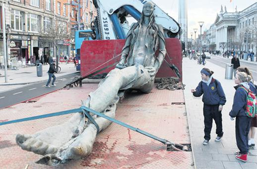 Sculptor Eamon O'Doherty's Anna Livia on a truck in O'Connell Street, Dublin, yesterday before it goes to her new home in the park opposite the Aisling Hotel Dublin