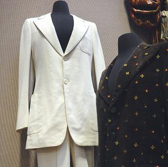 Two outfits worn by John Lennon that will be auctioned (AP)