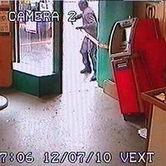 Bungling raiders were caught after the cash machine they were trying to steal got stuck in a doorway