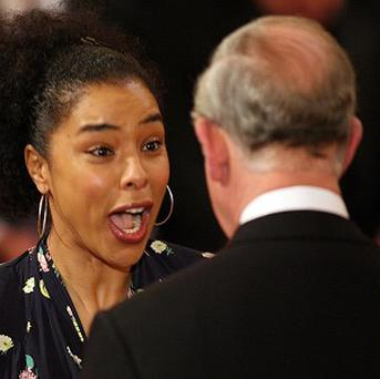 Sophie Okonedo reacts with surprise when her OBE award fell off her top