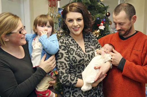 17/12/'10 Sile Seoige pictured with Euan O'Malley from Naas (10 days) and his parents Tom and Elaine and sister Catherine 1 1/2at during the Heinz Celebrity Ward Walk and Ho Ho Ho Day at Our Lady's Hospital for Sick Children, Crumlin this morning when a host of Irish celebritys walked the wards in the hospital and met some of the sick children...Picture Colin Keegan, Collins, Dublin.