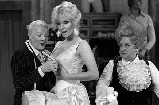 Undated file photo of John Inman (left) sizes up the situation as a member of the cast on