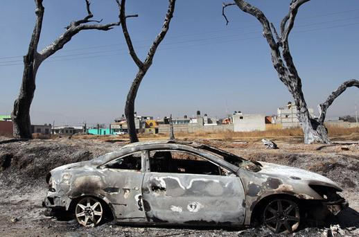 A burnt-out car at the site of the explosion of a Pemex pipeline in the village of San Martin Texmelucan, near Puebla, Mexico. Photo: Reuters