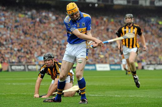 Tipperary's Lar Corbett scores his team's first goal in the All-Ireland hurling final as Noel Hickey looks on. Photo: David Maher / Sportsfile