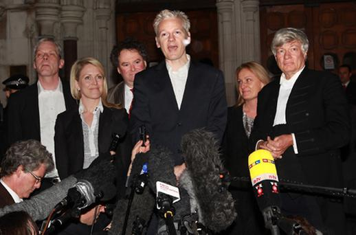 Julian Assange addresses the media outside the High Court in central London. Photo: Getty Images