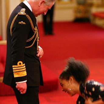 Sophie Okonedo picked up her OBE after the medal fell on the Prince of Wales' foot