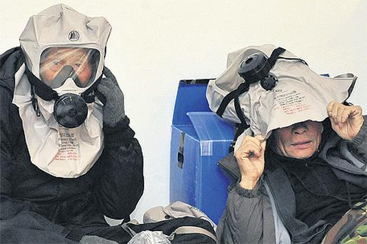 Residents wear gas masks in an air raid bunker on Yeonpyeong Island yesterday