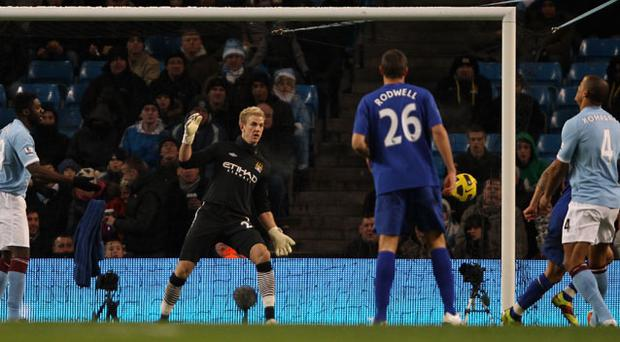 Goalkeeper Joe Hart can't prevent Tim Cahill opening the scoring for Everton. Photo: Getty Images