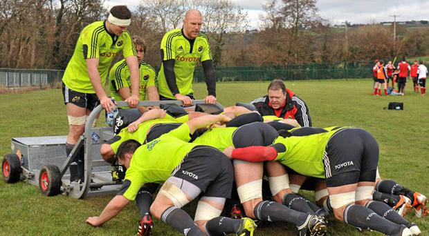 Munster players practise their scrum before last weekend's game against Ospreys when they struggled at the set-piece.