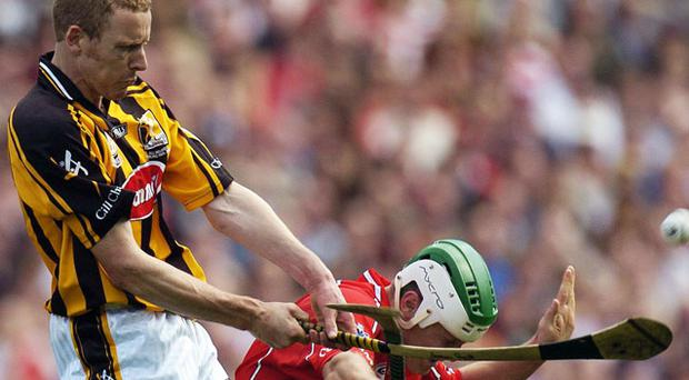 James Ryall in action against Niall McCarthy of Cork as Kilkenny claim the 2006 All-Ireland SHC title - the highlight of his Cats' career.