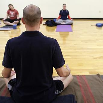 Yoga instructor Zack Lynn is offering free classes for the unemployed (AP)