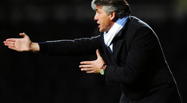 Roberto Mancini retains the support of Manchester City's owners despite some disappointing results in recent weeks. Photo: Getty Images