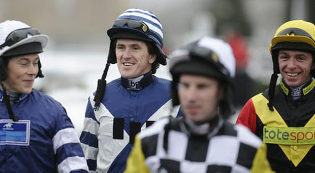 Newly-crowned Sports Personality of the Year Tony McCoy was all smiles as he returned to action at Kempton Park yesterday. Photo: Getty Images
