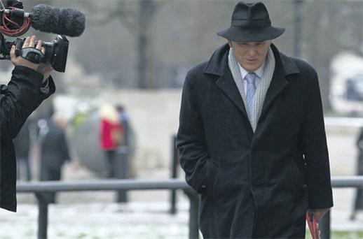 Britain's Business Secretary Vince Cable arrives at the Treasury in London yesterday