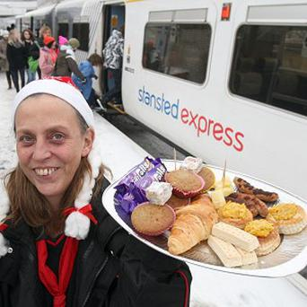 Railway station clerk Angela Milton has thrown a Christmas party for commuters in Cambridgeshire