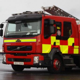 The firefighter fell ill after tackling a fire in the Kilwilkee estate in Lurgan last night.