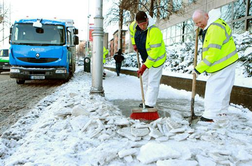 County Council workers clear snow as heavy winter snows and freezing temperatures continue to cause chaos around Dublin. Photo: PA