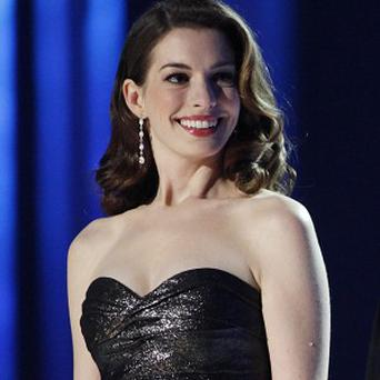Anne Hathaway isn't sure that she'll be singing in the Judy Garland film